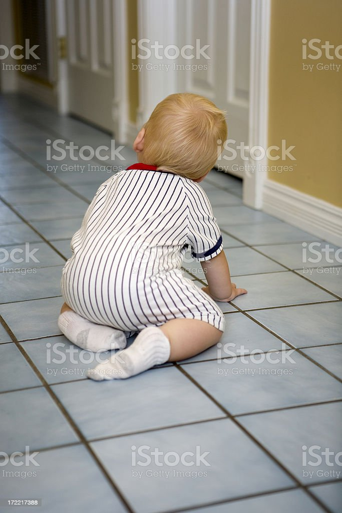 baby looking down dark hall royalty-free stock photo