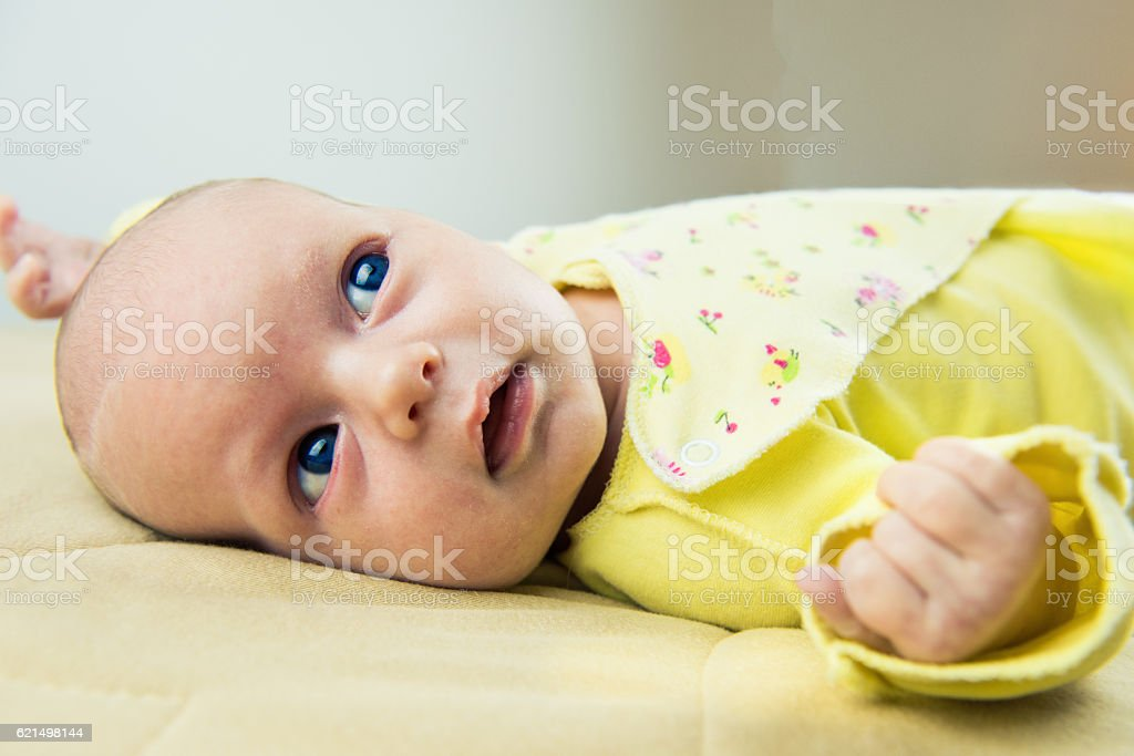 baby lying on a bed foto stock royalty-free