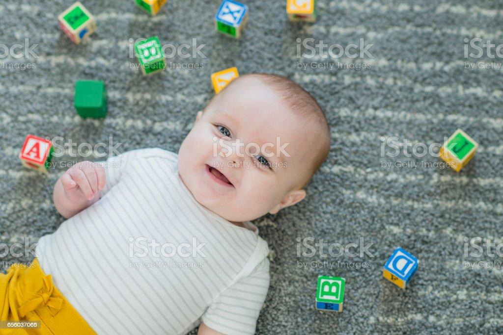 Baby Lying on the Floor stock photo