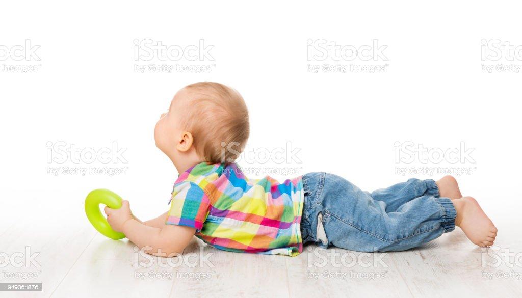Baby Kind zurück auf weißen Boden liegend hintere Ansicht Wegsehen, Kid erhobenen Hauptes – Foto