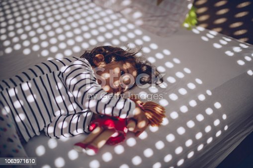 1008826222istockphoto Baby lying with toy 1063971610