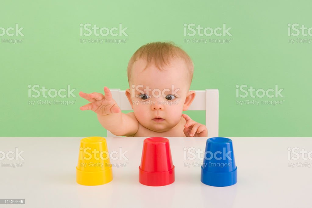 Baby makes a choice from three options stock photo