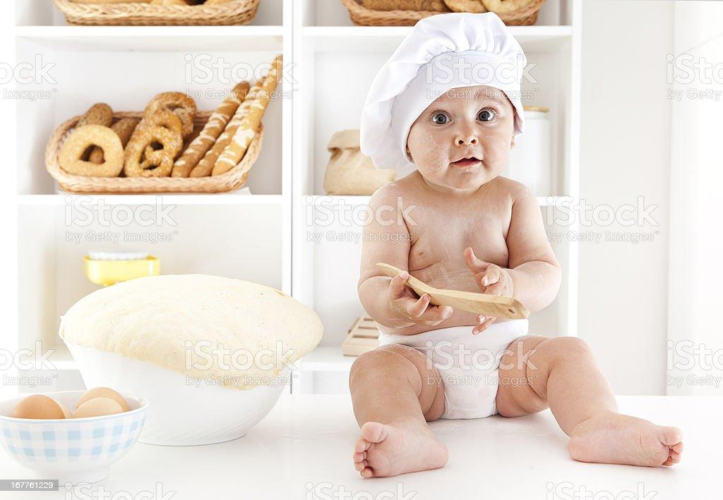 Baby Making Dough For Baking stock photo