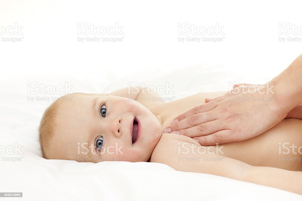 Baby massage stock photo