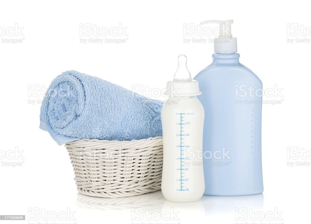 Baby milk bottle, shampoo and towel royalty-free stock photo