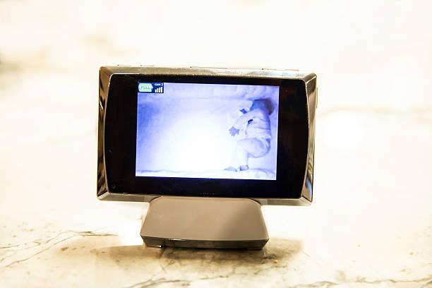Baby monitor screen with sleeping baby stock photo