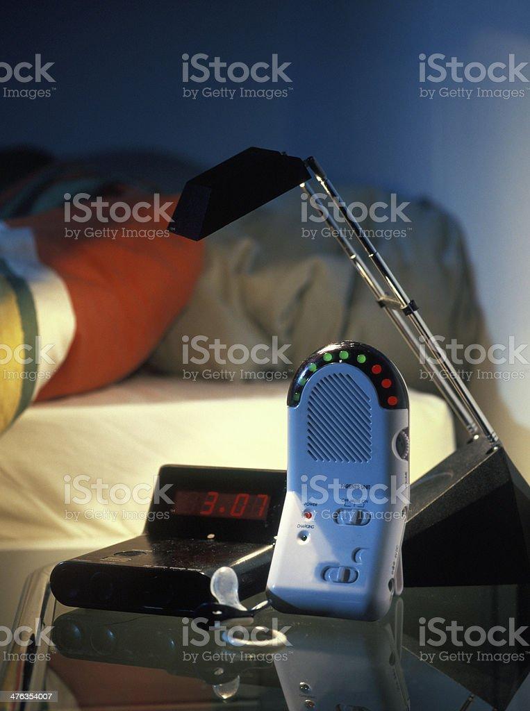 baby monitor waking up young parents at night stock photo