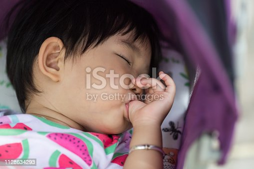 Baby napping and thumb sucking