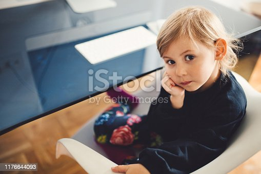 Baby girl near computer