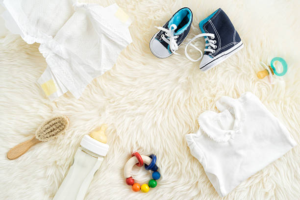 Baby necessities on a white for rug stock photo