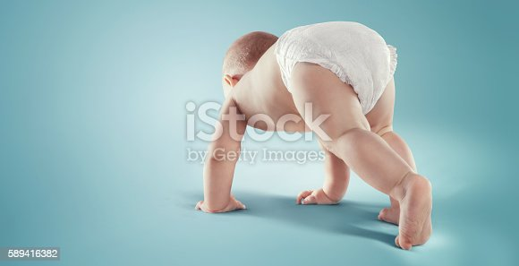 istock Baby. Newborn in the diaper. Isolated 589416382