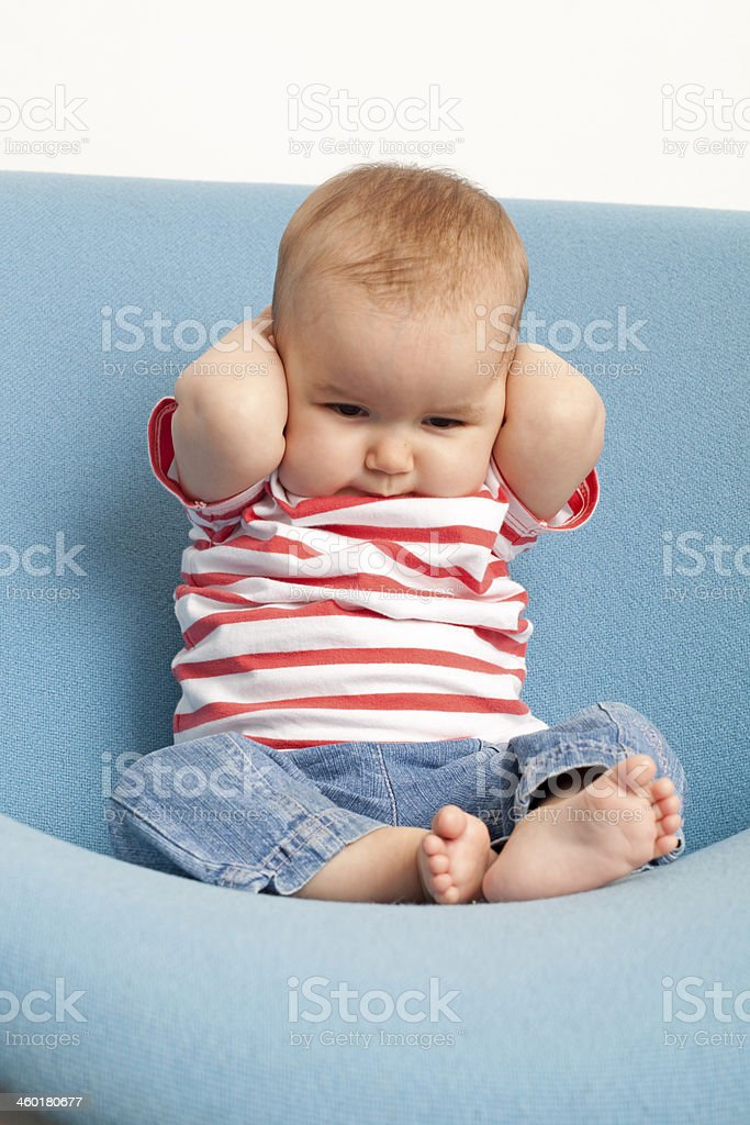 baby not willing to listen stock photo