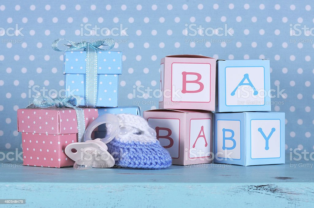 Baby nursery bootie, dummy pacifier and baby letters gift boxes​​​ foto