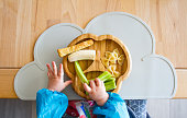 istock Baby nutrition BLW (baby-led weaning) with baby hands grabbing for food 1250273015