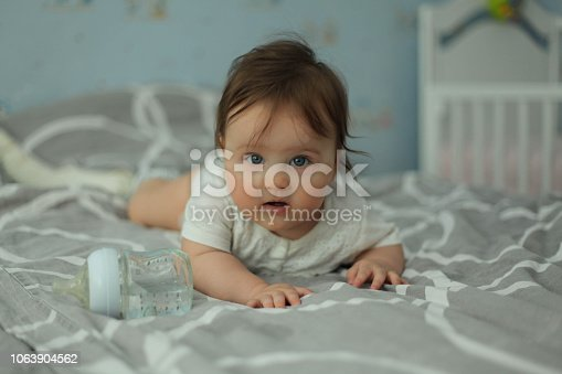 istock Baby on bed. 1063904562