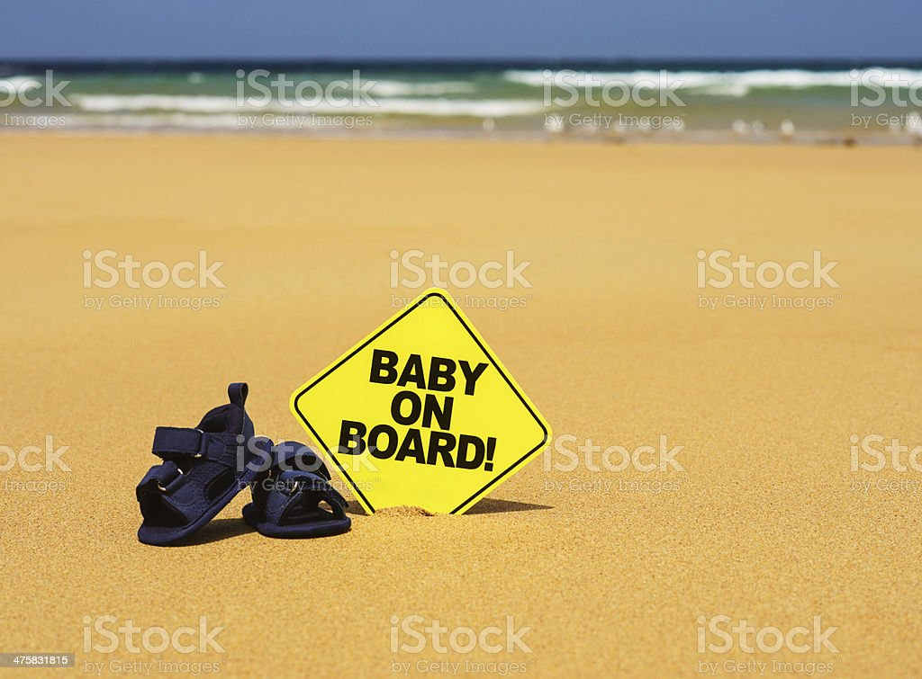 Baby on Board and Little Shoes stock photo