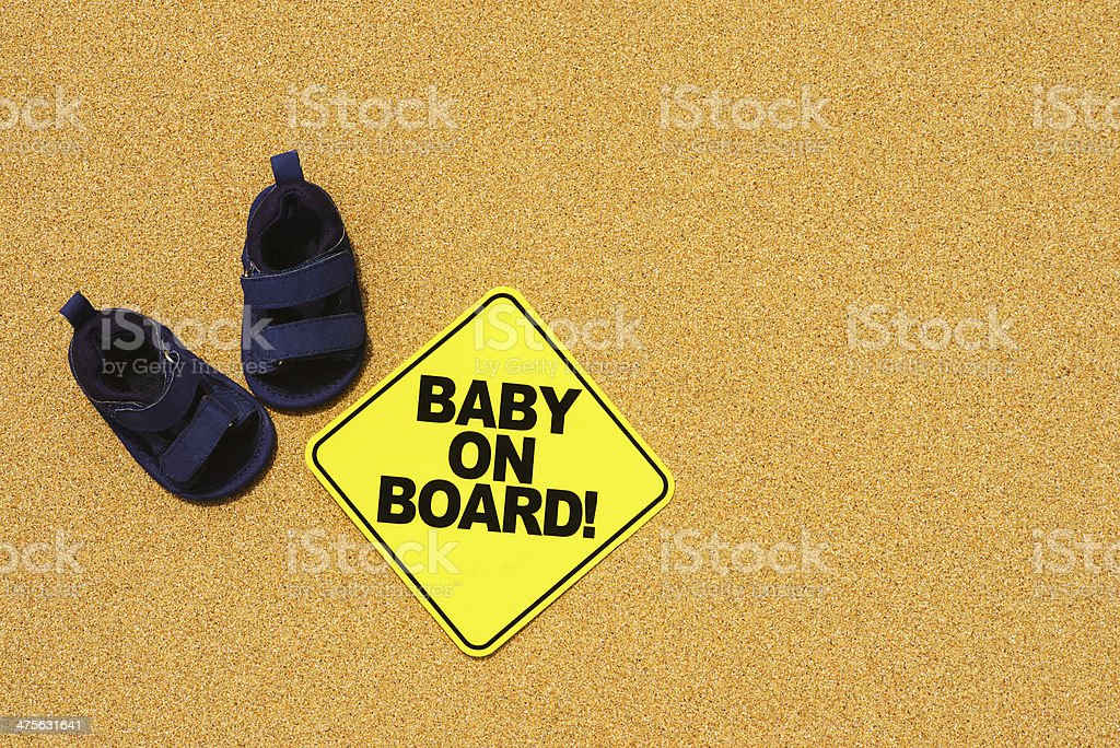 Baby on Board Sand Background stock photo