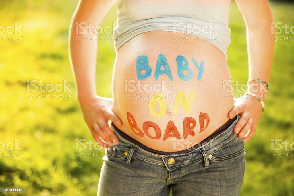 Baby On Board Written over Woman's Belly stock photo