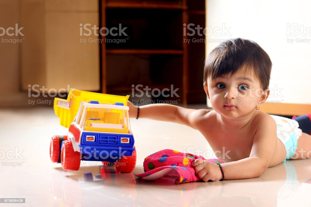 baby on ground with small truck toy royalty-free stock photo