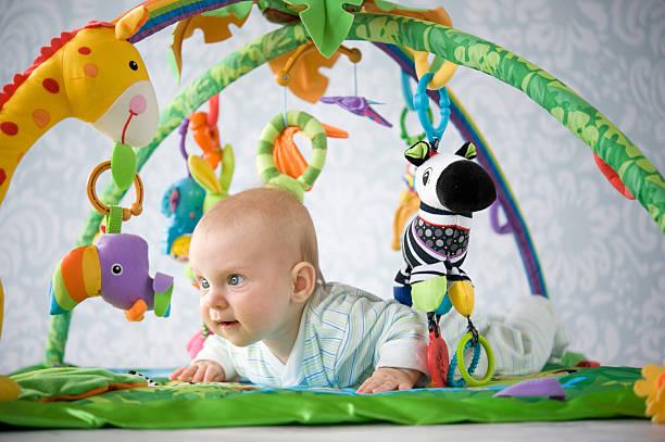 Baby on playmat stock photo