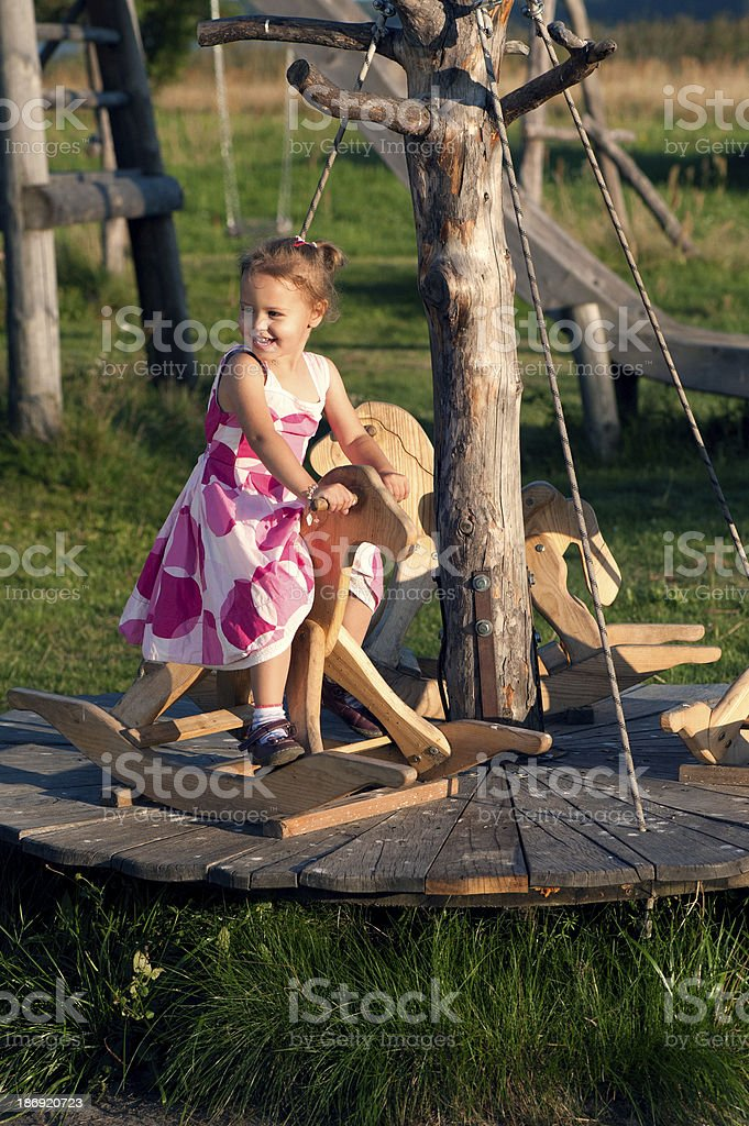 Baby on the cockhorse royalty-free stock photo