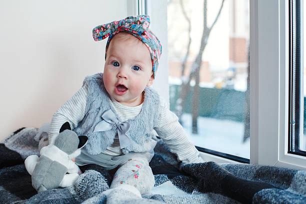 baby on the window - hunde strumpfhosen stock-fotos und bilder