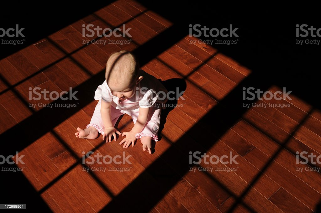 Baby on wood floor royalty-free stock photo