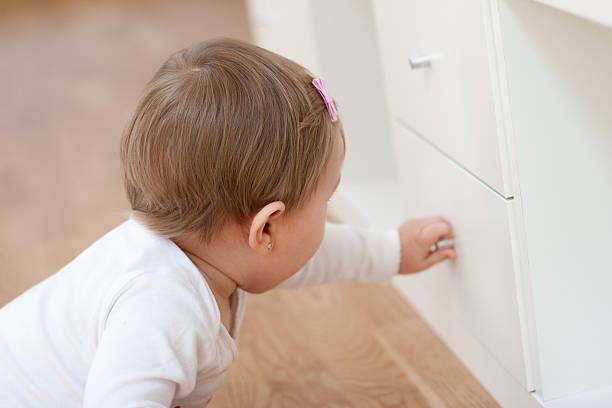 baby opening a drawer - looking inside inside cabinet bildbanksfoton och bilder