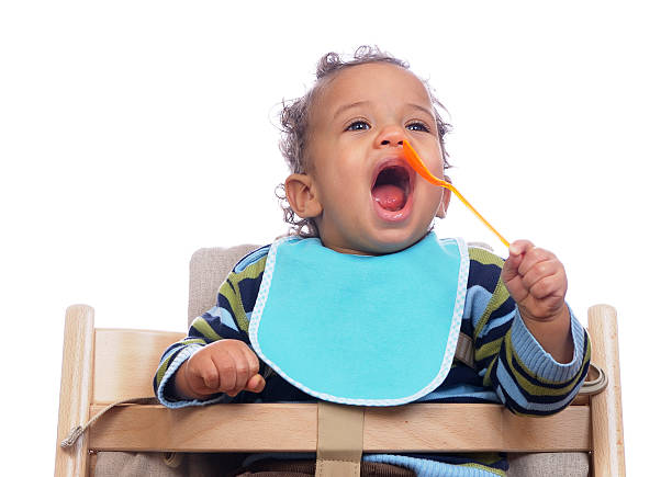 Baby Opening His Mouth And Trying To Feed Himself stock photo