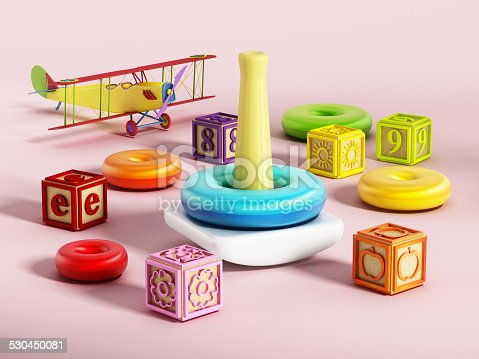 Baby or children educational toys.Educational pyramid toy with multi-colored plastic pieces.