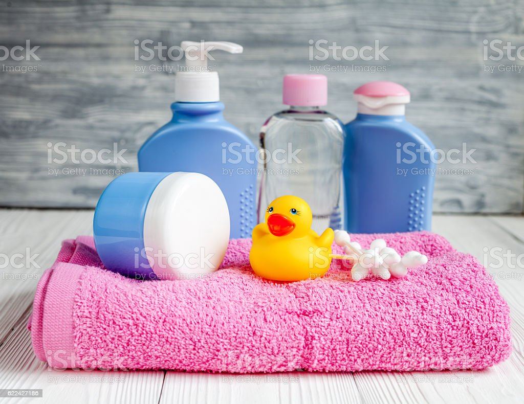 baby organic cosmetic for bath on wooden background stock photo