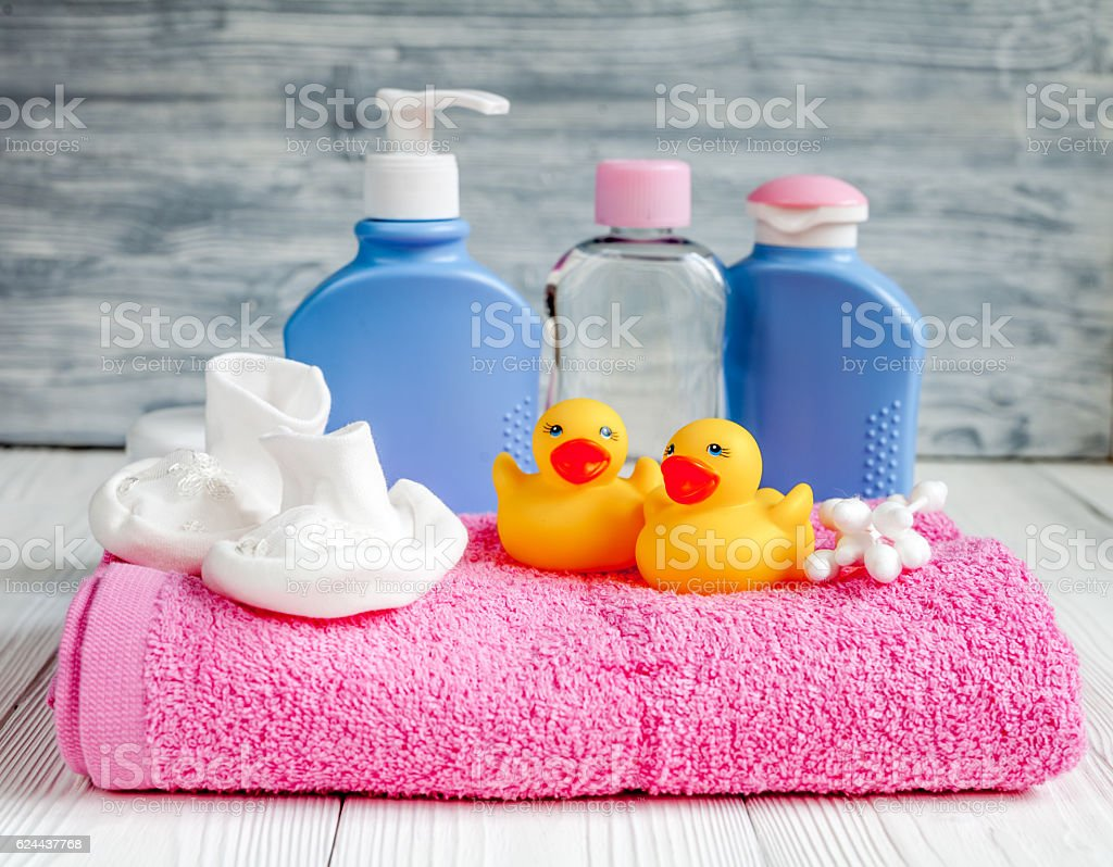 baby organic cosmetic for bath on wooden bakground stock photo