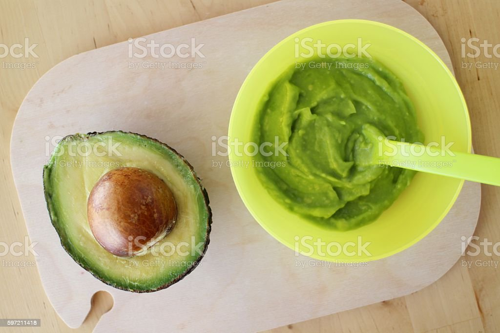 Baby organic food avocado puree stock photo