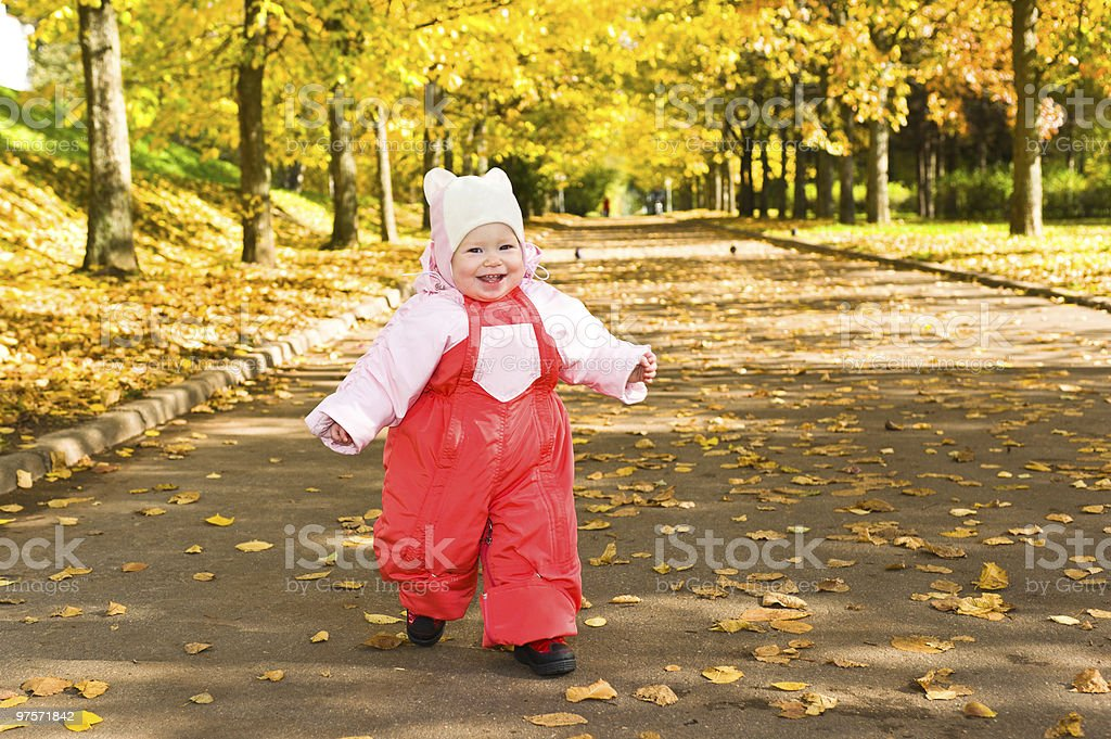 Baby outdoors at autumn park royalty-free stock photo