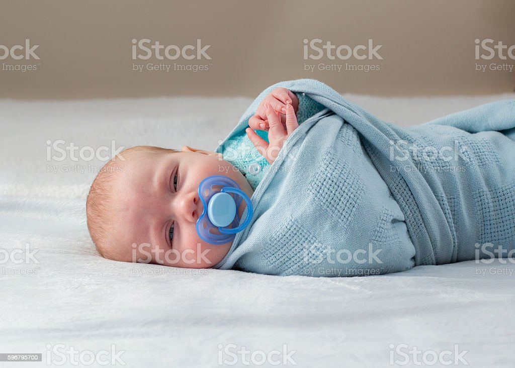 Baby peeking stock photo