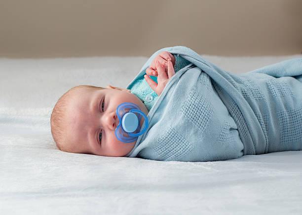 Baby peeking stock photo
