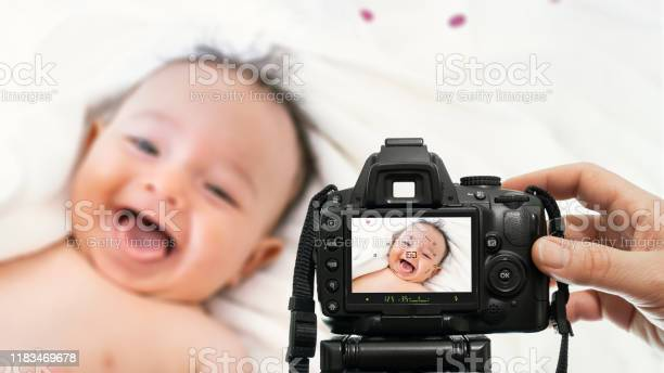 Baby photography with dslr camera picture id1183469678?b=1&k=6&m=1183469678&s=612x612&h=rgwaf8rql1opb7k8lkfg6ya8612iaqrlvask9mm8brm=