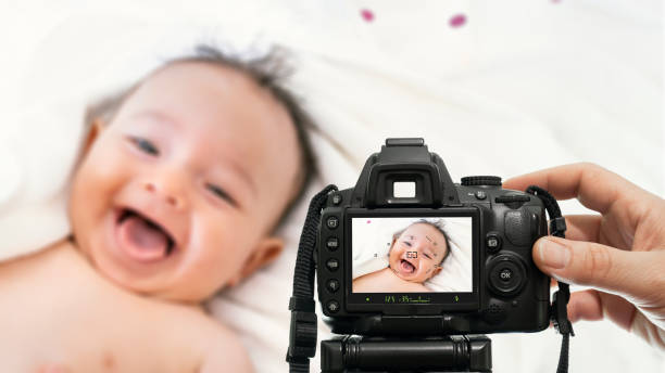 baby photography with dslr camera stock photo
