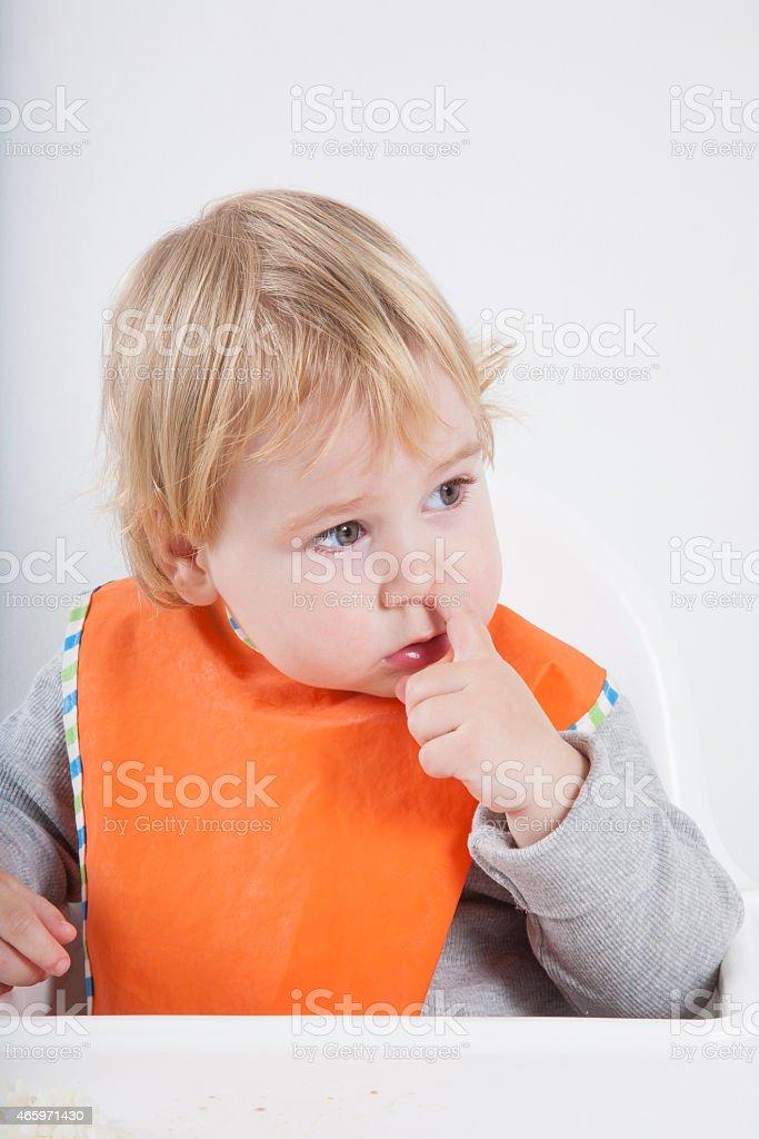 baby picking nose stock photo