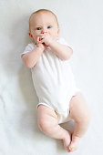 Adorable four-month-old baby from above.