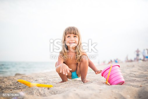 istock Baby play in sand 527676084