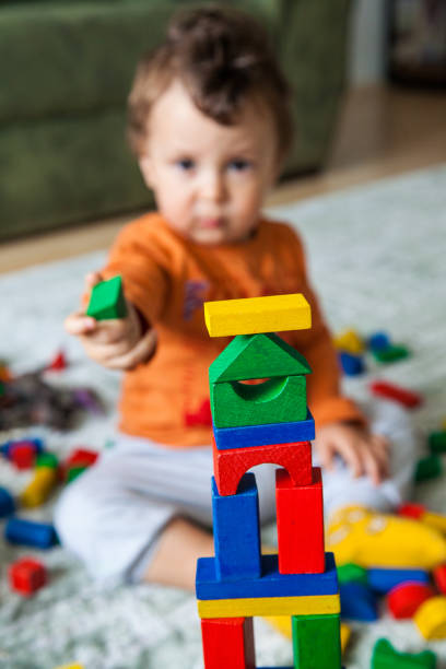 Baby play with toy stock photo