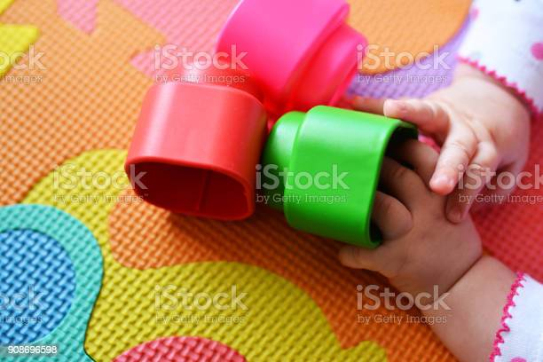 Baby playing and discovery with colorful toy block at home picture id908696598?b=1&k=6&m=908696598&s=612x612&h=ni38pie9dxqq3rw84171lz05ih5rwkznuexriadbedq=