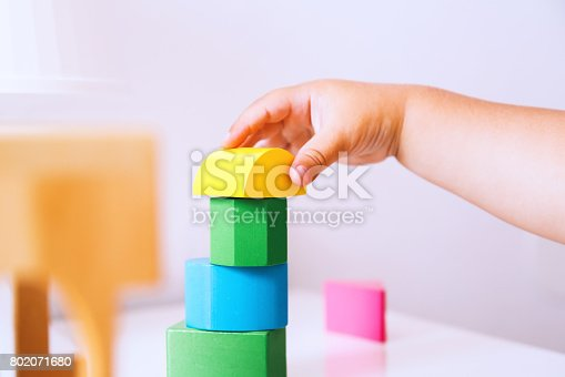 istock Baby playing and discovery with colorful toys at home, close-up detail. 802071680
