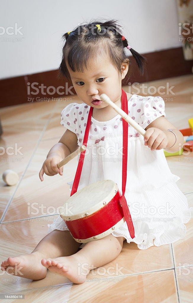 Baby playing Drum stock photo