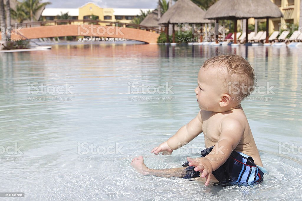 Baby Playing in Pool stock photo