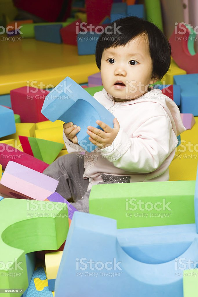 Baby playing toy stock photo