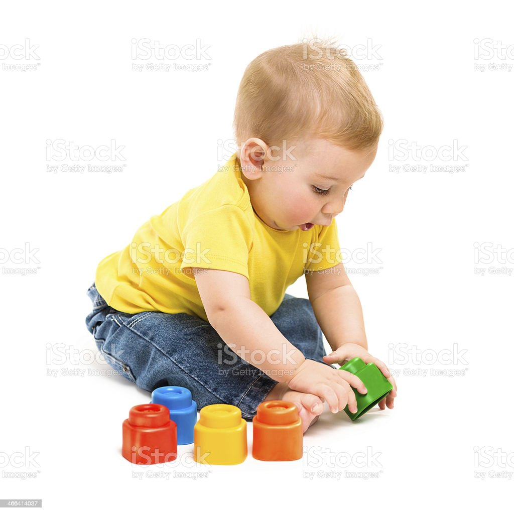 Baby playing with block toys isolated on white background royalty-free stock photo