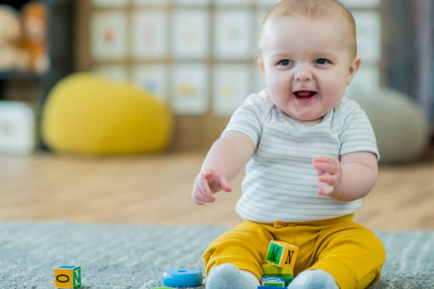 Baby Playing with Blocks stock photo