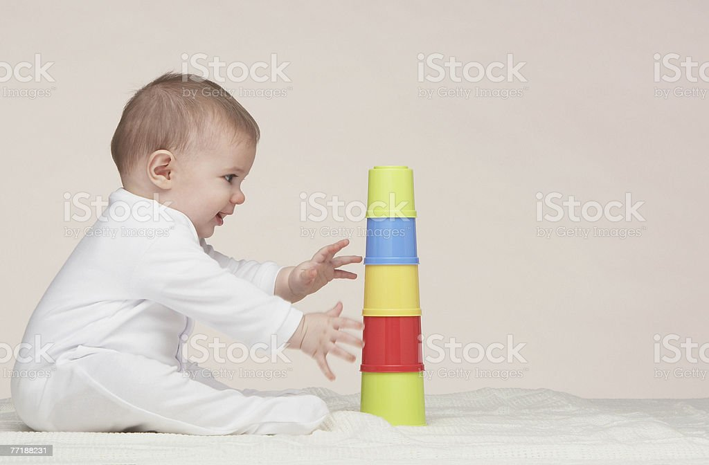 A baby playing with building toys stock photo